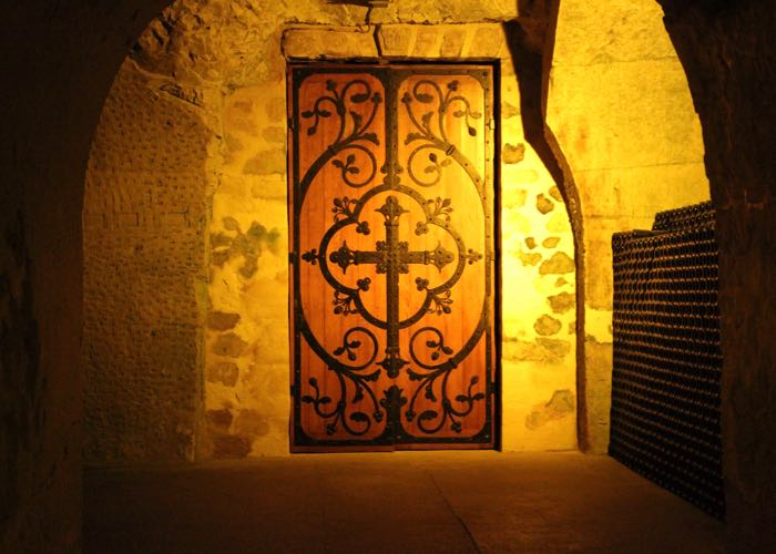 Mysterious door during a visit of the cellar of Ruinart Champagne for a luxury wine day tour to Champagne