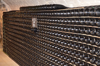 Bottles of champagne ageing in cellar, The greatest players of Champagne's history
